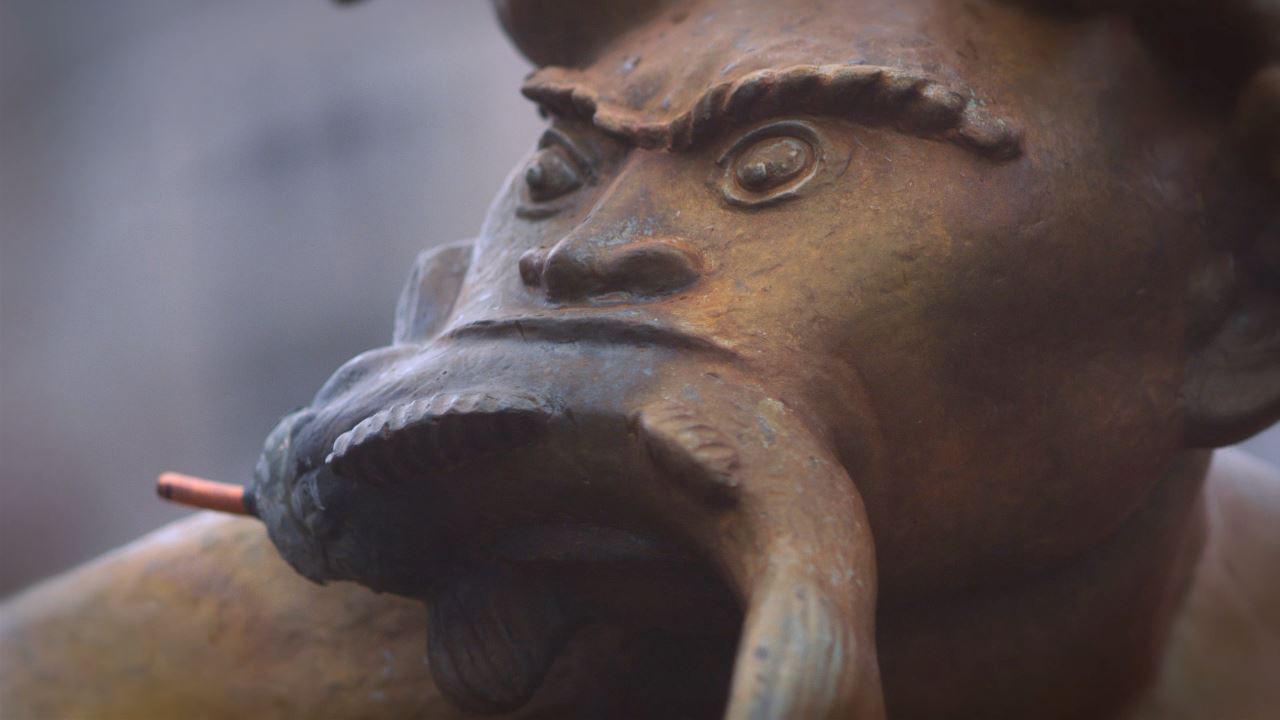 statuefishinmouth
